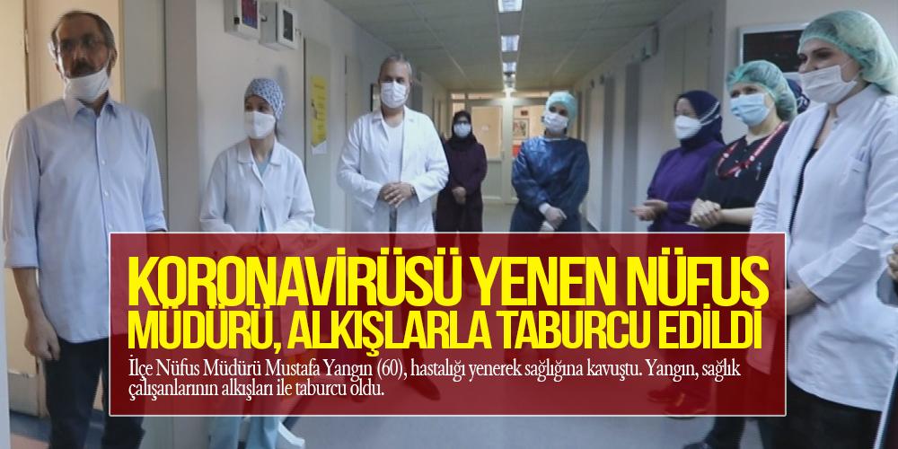 Koronavirüsü yenen nüfus müdürü, alkışlarla taburcu edildi