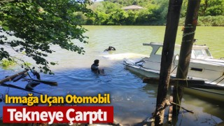 Irmağa uçan otomobil, tekneye çarptı