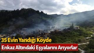 35 evin yandığı köyde, enkaz altındaki eşyalarını arıyorlar