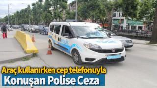 Araç kullanırken cep telefonuyla konuşan polise ceza