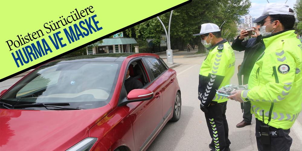 Polisten sürücülere hurma ve maske
